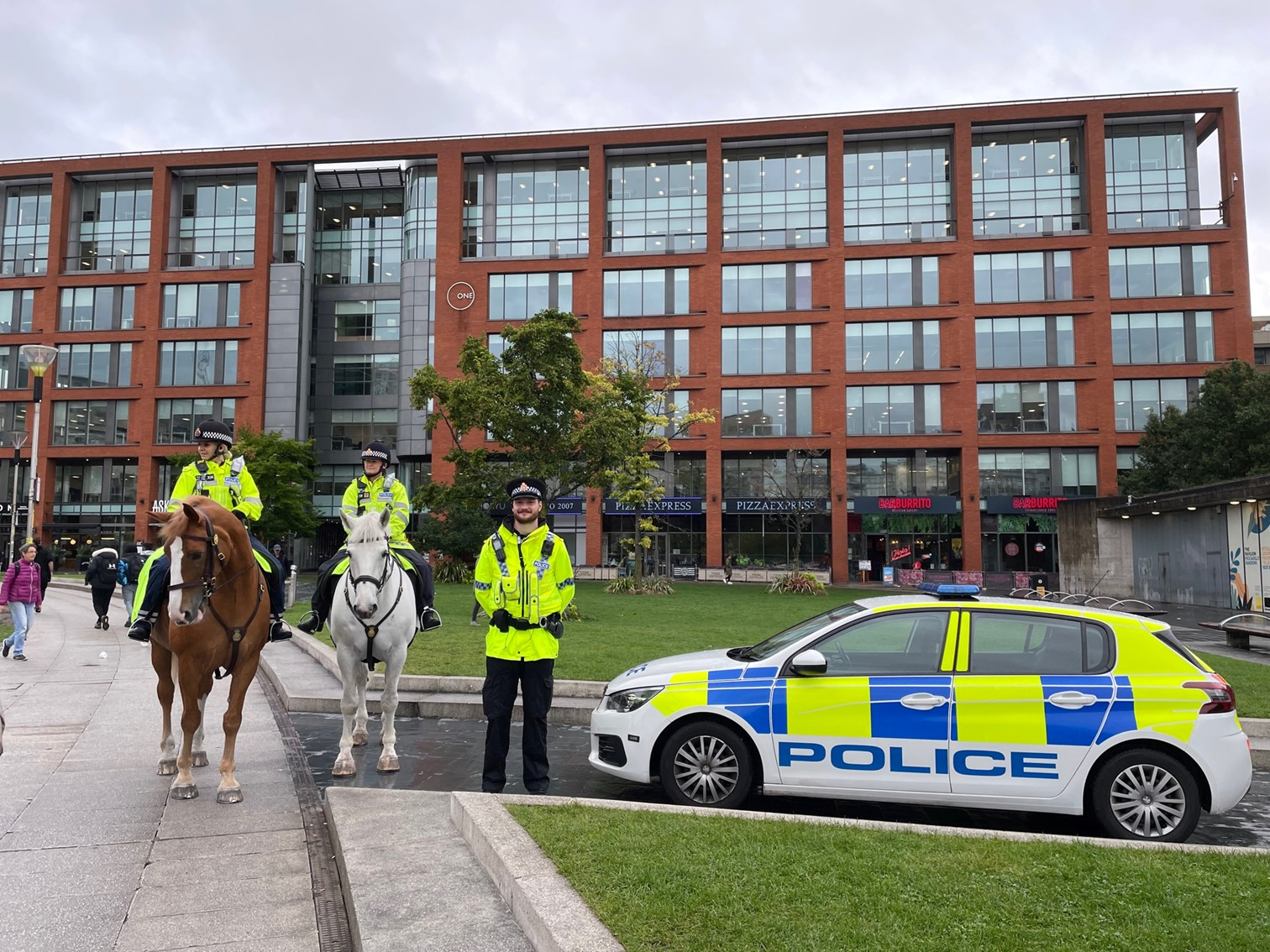 PC Lomas alongside GMP police horses Bumble and Hexam in Piccadilly Gardens-2